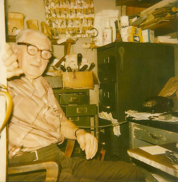 Charles Rubenstein in his penny arcade office, above the subway at 42nd St. & 8th Avenue.