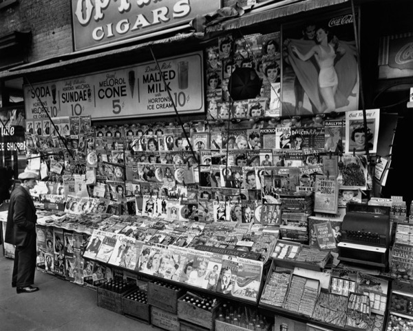 Open-air newsstands were common in New York throughout the 20th century. (photo by Berenice Abbott, 1935)
