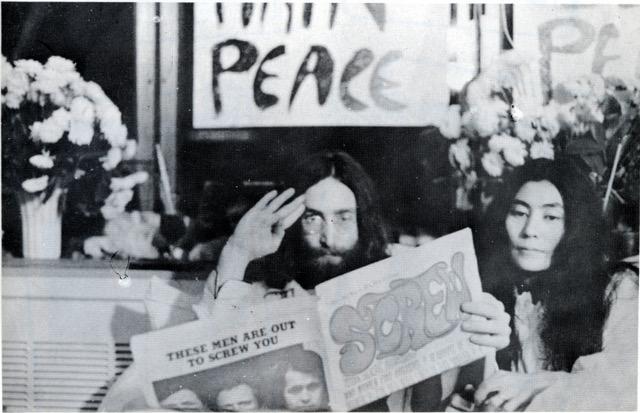 John Lennon and Yoko Ono reading Screw magazine